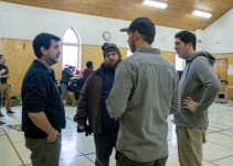 Director Lee Foster consults with crew members Aaron Peacock, Bryan Piggott, and Aidan Kennedy!
