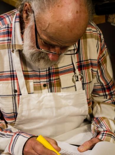 Actor Michael Buchanan studies the script behind the scenes!