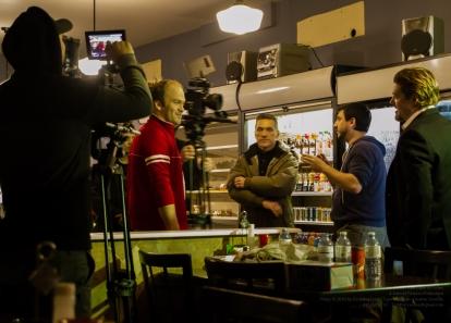 It's all an act: Actors Aaron Heels, Elvis Stojko, and Thomas Scott receive direction from Director Lee Foster as Director of Photography Bryan Piggott prepares!