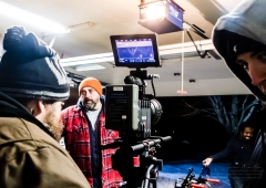 Crew members Aaron Peacock and Aidan Kennedy prepare for the scene while actor Ryan Way takes direction!