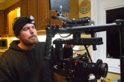 Crew member Andrew Gerhold prepares the equipment for another scene!