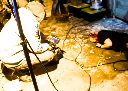 Director of Photography Bryan Piggott surveys the carnage. The current victim is Ted Paulsen.