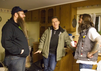 Producer Ryan Kobold and actors Elvis Stojko and Sean Leppington chatting behind the scenes.